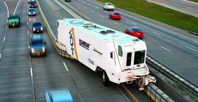 Barrier Transfer Machine Sistema de barreras móviles para la canalización del tráfico por carretera
